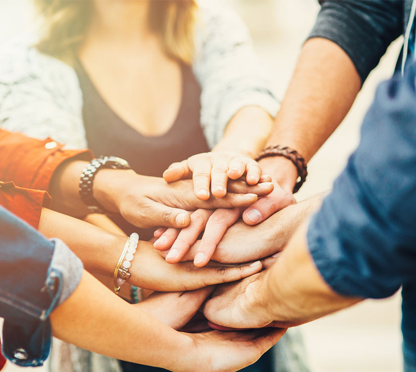 team-work-hands-image-840x751
